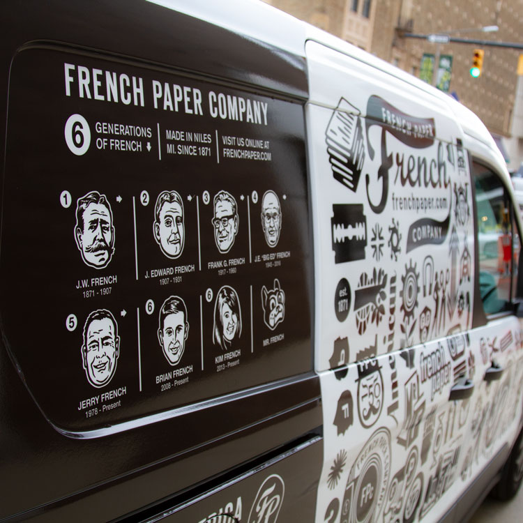 side of french paper van
