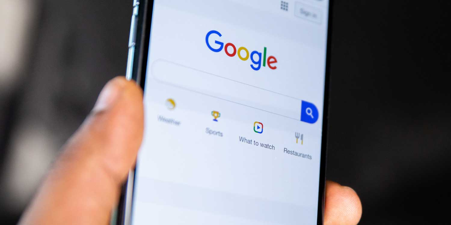 google on phone in hand