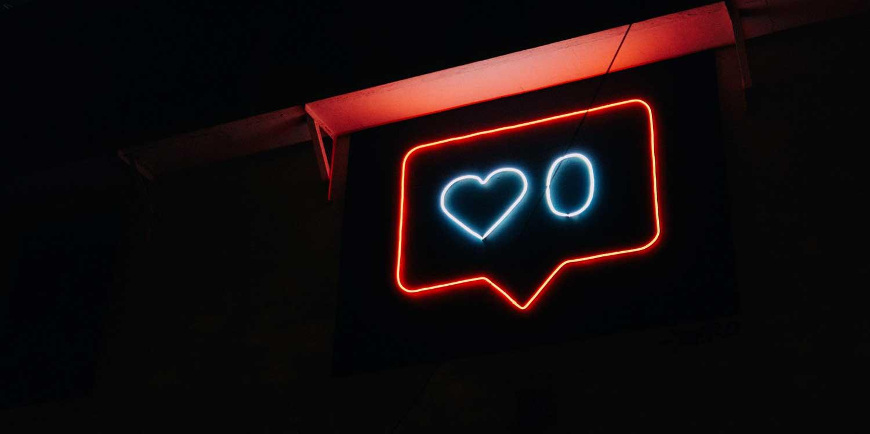 neon social media like sign